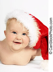 Santa Baby - Beautiful jolly blue eyed baby in Santa Hat