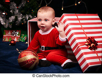 Santa baby boy for christmas in a gift wrapped box - Gift...