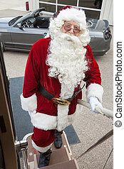 Santa Boarding Private Jet With Convertible In Background