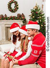 santa, chapeaux, tablette, famille