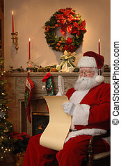 Santa sitting near the fireplace checking the list of good boys and girls