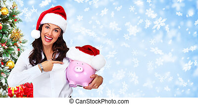Santa helper business woman with a piggy bank over Christmas background.
