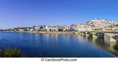 Santa Clara Bridge with the old town on the hill in the background. Coimbra, Portugal