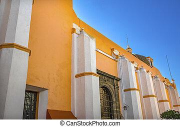 Orange Facade Santa Clara de Asis Church Historic Puebla Mexico. Clara de Asis was female follower of St. Francis of Assisi. Built in 1600 to 1700s