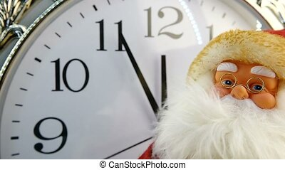 santa Claus against the background of hours on New Year's Eve
