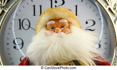 santa Claus against the background of hours on New Year's...