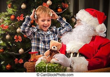 Santa Claus and a little boy