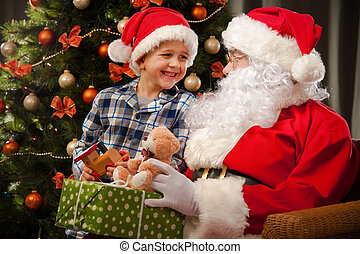 Santa Claus and a little boy