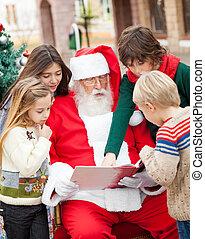 Santa Claus And Children Reading Book