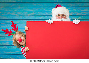 Santa Claus and reindeer child holding banner blank. Merry...