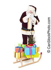 Santa Claus and sled with many Chirstmas presents