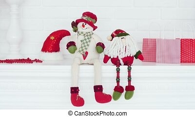 Santa Claus and snowman on the background of a toy house. Christmas and New Year's toys