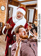 Santa claus as master at barber shop