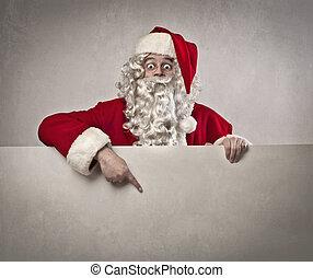 santa claus billboard - santa claus shows his finger on...