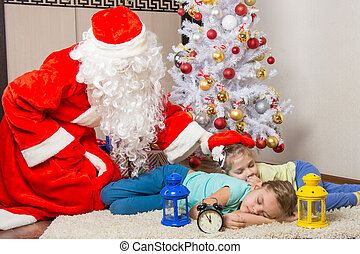 Santa Claus brought gifts and pats on the head of sleeping...