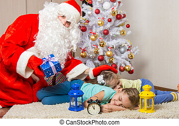 Santa Claus brought gifts, pats on the head of sleeping...