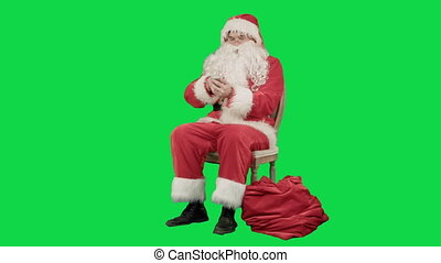 Santa claus calling by mobile cell phone on a Green Screen...
