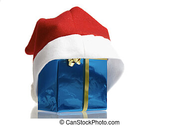 Santa claus cap pulled over a blue christmas package