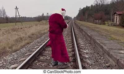 Santa Claus check gift bag on railway
