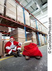 Santa claus checking list of gifts