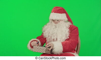 Santa Claus: Cheerful Gifts on a Green Screen Chrome Key -...