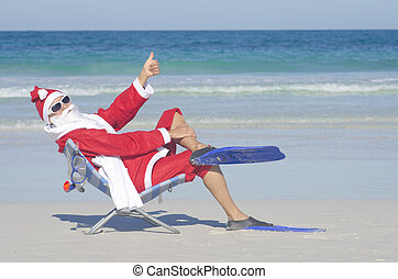 Santa Claus Christmas at Beach - Santa Claus sitting with...