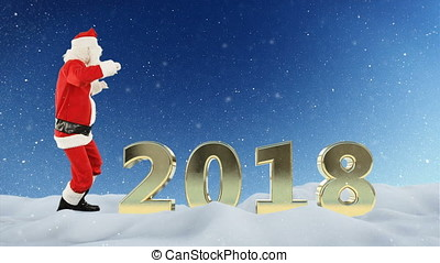 Santa Claus dance and 2018 sign against snow