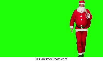Santa Claus dancing in costume