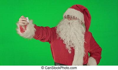 Santa Claus doing a selfie on a Green Screen Chrome Key