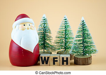 Santa Claus doll and christmas tree with WFH. Concept quarantine at home.
