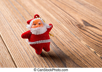 Santa Claus doll on a wood background