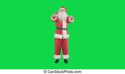 Santa Claus drinking hot tea or coffee and wishes Merry Christmas on a Green Screen, Chroma Key.