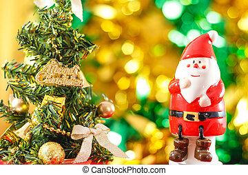 Santa Claus figurine with Christmas tree