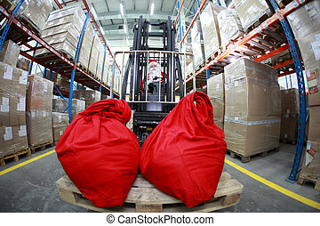 santa claus   forklift in warehouse