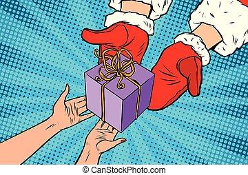 Santa Claus gives Christmas gift