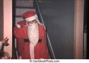 Santa Claus Gives Christmas Gifts - A sister poses as Santa...