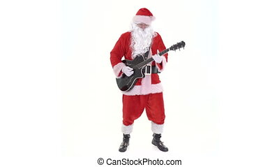 Santa Claus guitar player plays rock and roll. Santa is guitarist playing acoustic electric guitar, singing Christmas song on white background.