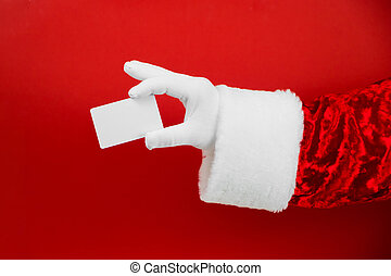 Santa Claus hand holding blank plastic credit card on red background with Clipping Path. Shopping, Sales, Giving Gift for Black Friday, Christmas and New Year concepts