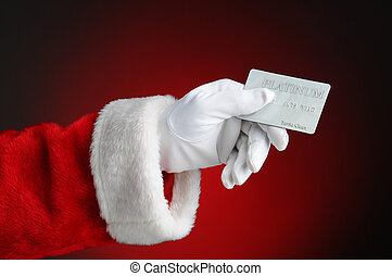 Santa Claus Hand Holding Credit Card