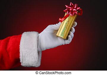 Santa Claus Hand Holding Present