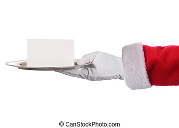 Santa Claus hand holding silver tray and blank note. Horizontal format arm with hand only.