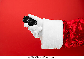 Santa Claus hand holds car keys. Merry Christmas and New Year concept. New car smart key. Buyer, property, buy, rent, sale, truck, cars concept