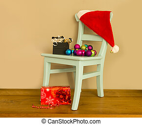 santa claus hat on chair with presents