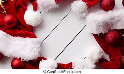 Santa Claus hats on white wooden desk with blank copy space....