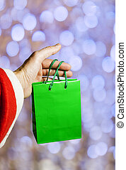 Santa Claus holding a bag with gifts