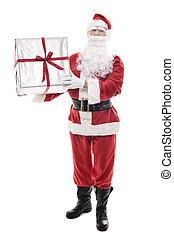 Santa Claus holding a big christmas present