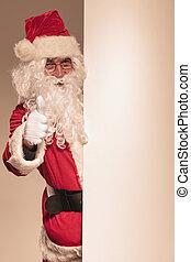 Santa Claus holding a blank panel
