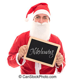 Santa Claus holding a board with german Word Nikolaustag, isolated on White, concept saint nicholas
