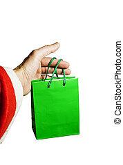 Santa Claus holding a gift bag i