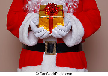 Santa Claus holding a gift wrapped present with gold...